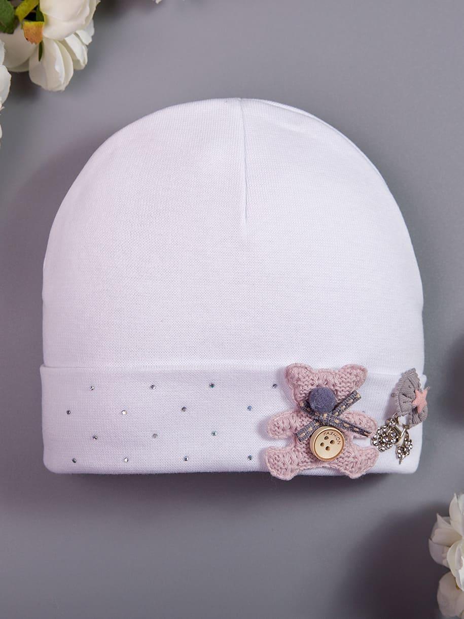 Шапка трикотажная формы лопата для девочки, на отвороте стразы и розовый мишка, белый